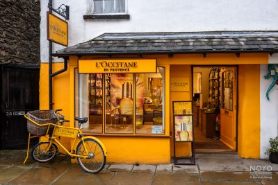 Photo of vividly painted L'Occitane shop by Norman Young