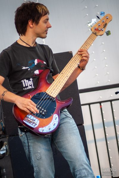 Photograph of Superhero bassist by Norman Young