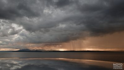 Photograph of rain over the Isle of Bute by Norman Young